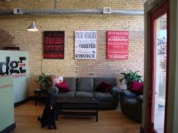 advertising agency office design. an ad agency dresses up their industrial modern office space with canvas gallery wraps of graphic advertising design