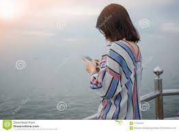 Young Women Stand Alone Holding Mobile ...