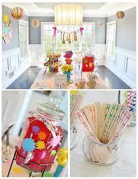 art themed birthday party paint splattered drink dispenser hanging paint brushes paint splashes on wall