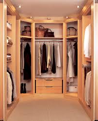 interior brown wooden closet with shelves also space for hanging clothes placed on the white