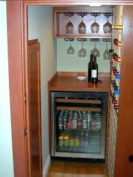 under stairs wine cellar plus small beverage center also wooden door and open closet ideas basement home