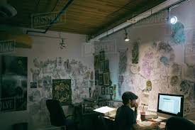 artist office. Dedicated Tattoo Artist Working At Computer In Studio Office