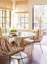 a touch of midcentury courtesy of the marble top tulip table and rattan chairs brings a sophisticated sense of boho style into the mix