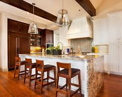 pendant kitchen lighting ideas. this stunning kitchen was designed by garrison hullinger interior design inc and features berenson metro hardware pendant lighting ideas d