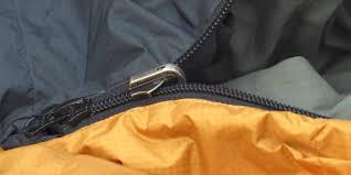 a sleeping bag zipper slider with a missing zipper pull