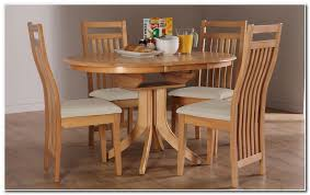 round extending dining table and 6 chairs