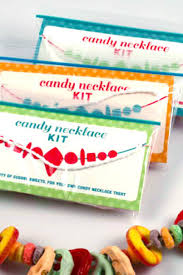 cut the string to make the necklace as long or as short as you d like cut ¼ inch s in either side of the label printout and carefully wrap the