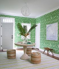 green foyer with round wood table at center of room