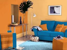 This living room is a complementary color scheme because of the orange and  blue colors that are opposite of eachother on the color wheel.