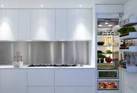 above left by keeping the design of this kitchen uncluttered and uncomplicated domus made the space bright and versatile because there are no handles or