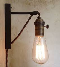 amazing plug in wall sconce hanging on the iron and glass materials lights on