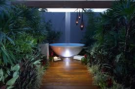 rain shower above the bathtub in the patio design dean herald rolling
