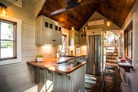 this particular denali model pushes the limits of a typical tiny home and manages to include a bedroom bathroom open floor plan kitchen