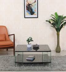 sy centre table with glass top in black colour by looking