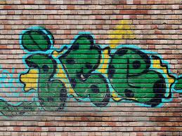 free graffiti image painted on brick