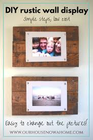 diy rustic wall display using reclaimed wood pallets and paper this diy wall art