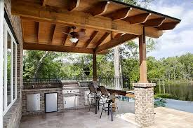 Outdoor Summer Kitchens With Iron Swivel Chairs
