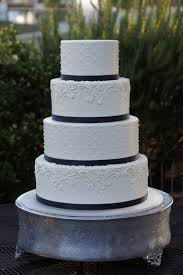 Simple And Elegant Wedding Cake With Dots And Fancy Scrolling