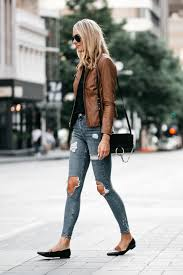 blonde woman wearing tan leather jacket black tshirt denim ripped skinny jeans outfit black tan loafers