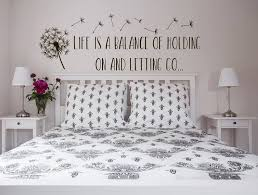 life is a balance holding on letting go wall decal e image 0