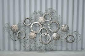 how to hang large metal wall art