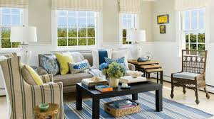 Horizontal shiplap wainscot wraps the walls in this Provincetown,  Massachusetts living room, where the