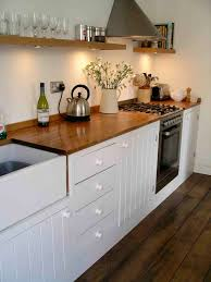 traditional bespoke kitchen with painted tongue and groove doors ste