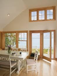 andersen fiberglass series hinged patio doors frenchwood hinged inswing patio door with pine interiors and brass hardware