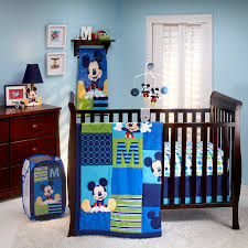 kids room brown polished wooden baby crib with mickey themes of blue bedding set also