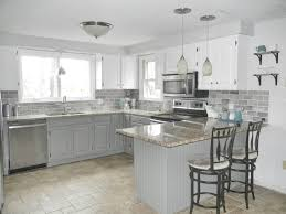 oak kitchen makeover 2 toned gray and white cabinets and gray subway tile for