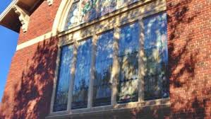 hail damage repair for church stained glass windows in houston