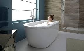 stand alone bathtubs woman taking a bath in her freestanding bathtub stand alone bathtubs modern