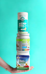 stack of protein powders as part of an extensive review of vegan protein powders
