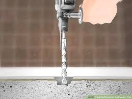 image titled remove bathroom tile step 7
