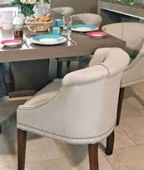 love low back dining chair make smaller rooms look not so crowded