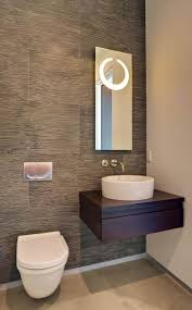 amazing contemporary powder room designs also floating vanity and cool  washbowl and floating toilete design also small mirror with cool lights  also modern ...