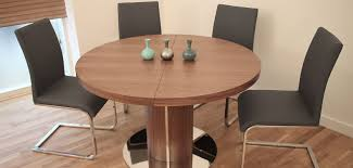 stylish black chairs without arms design and elegant round expandable kitchen table feat wooden interior floor
