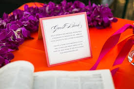 indian wedding party favors. guest book sign with dictionary for guests to find a descriptive word the couple; gold bowls at indian hindu wedding party favors