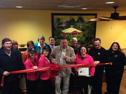 tropical smoothie cafe owner paul pococke center with scissors at the midland area chamber