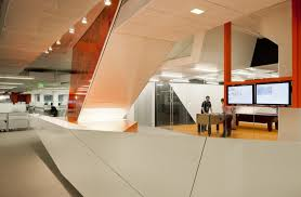high tech office design. kayak startup tech office- high gloss panelling in white and orange with down lighting office design c