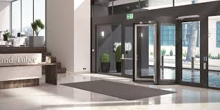 interior office door. ASSA ABLOY RD100 Frame Revolving Door In An Interior Office Environment.