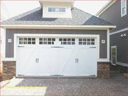 coachman white garage door with long panel windows and black iron hardware