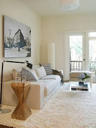 Attractive Contemporary White Living Room With Clear Coffee Table
