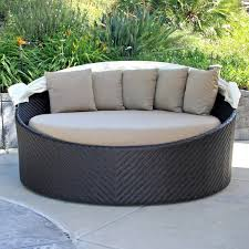 Decorating Black Wicker Sunbrella Cchair With Tan Sunbrella