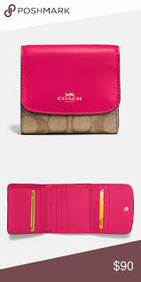 BNWT Coach signature bright pink  khaki wallet So cute! Perfect fit for  small or large bag! Big discount! In original coach packaging with tags  attached!!