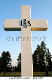 stock photo large cross with the greek ihs symbol for jesus christ in raised letters at a small town