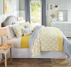 a reversible comforter and coordinating pillows offer multiple options for a bedroom refresh pair neutral yellow and gray