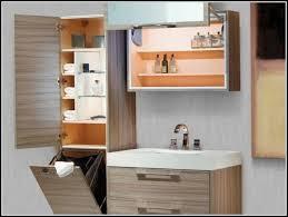 bathroom linen tower with hamper