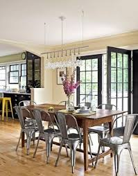 dining room with farm table metal chairs black french door wish i could see this kitchen
