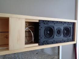 to separate the left and right speakers to the correct locations for optimal sound we skinned the mantle face in black steel matching the custom tv